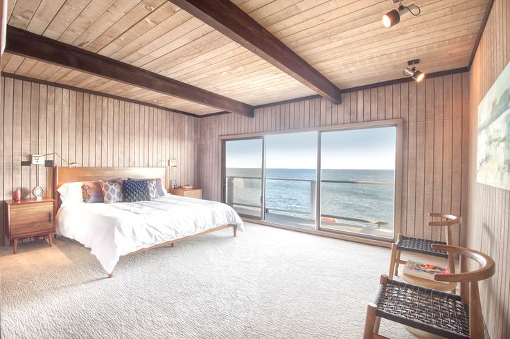 The home has three bedrooms and three baths. The master suite, pictured here, includes two full bathrooms, a gym and a dry sauna.