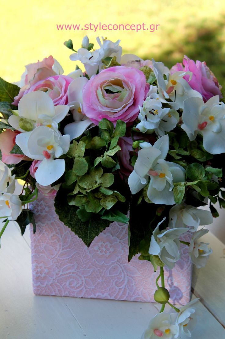 One of our favorite creations with pastel flowers in a lace-covered box.