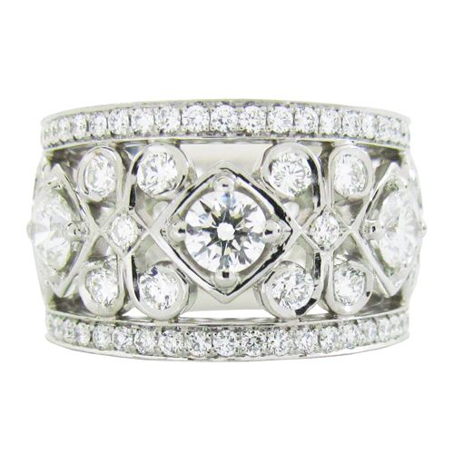 DIAMOND SCROLL RING  A custom designed, diamond anniversary ring has a scroll pattern that goes all the way around. (R610)