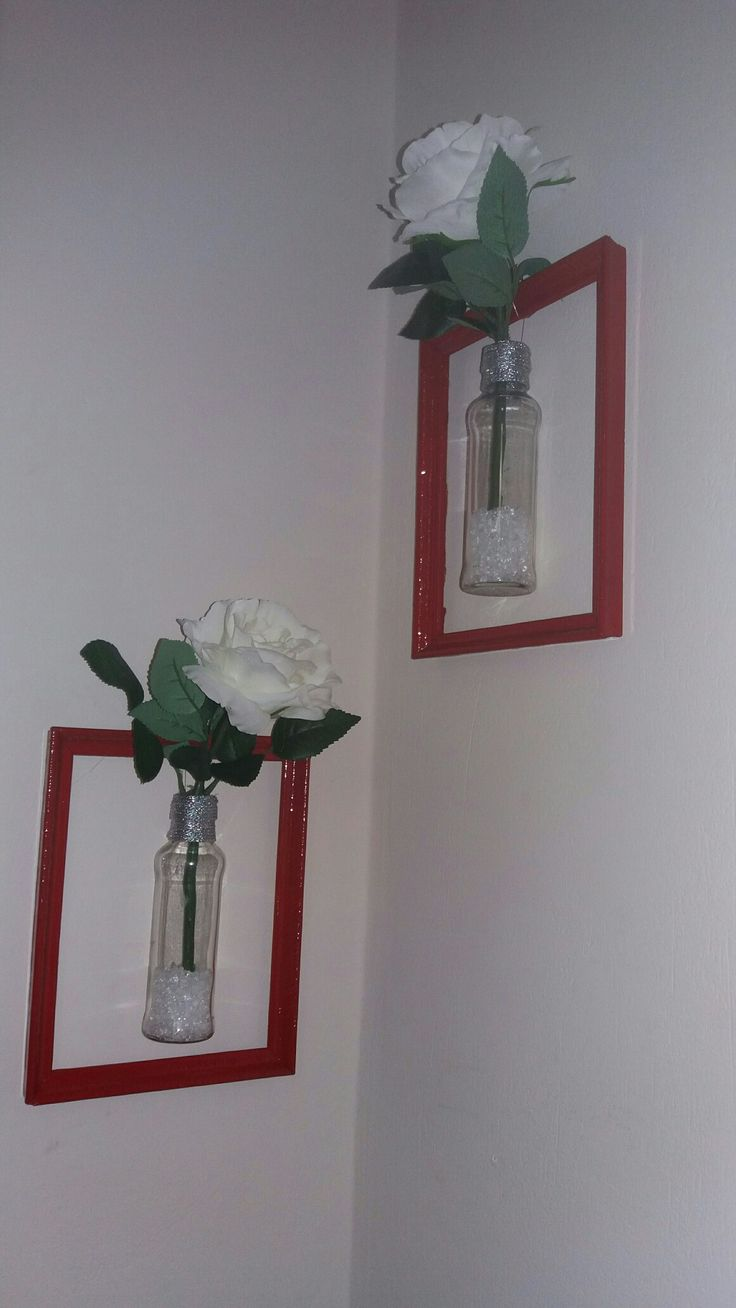DIY wall decor vases / pictures.  Recycle your old picture frames and small bottles into beautiful wall decor vases.