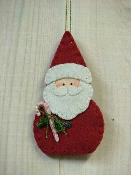 collection of felt ornaments -- some patterns, but not this Santa