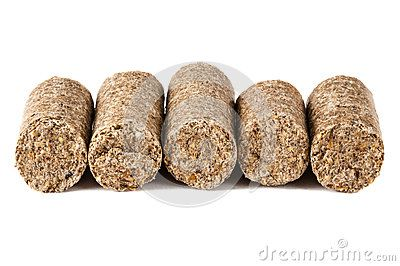 Horse feed, 16 mm diameter, pellet form, close-up.  on white background.