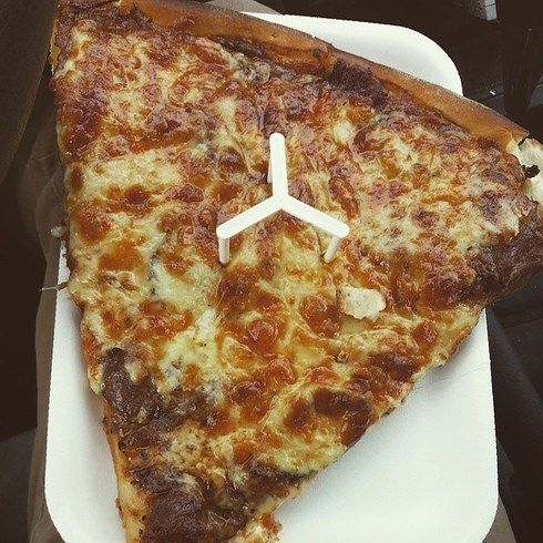 A slice of pizza (with donair sauce) from Pictou County Pizza in Halifax, Nova Scotia