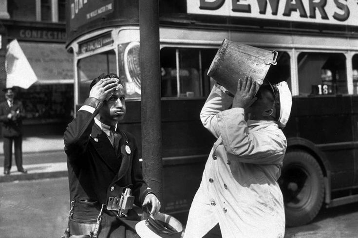 c1935:  A bus driver and conductor stop for a water break during a heatwave in London.  (Photo by Topical Press Agency/Getty Images)