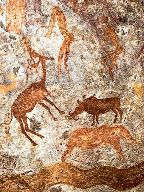Detail from a large panel of San/Bushman paintings in Mashonaland, Zimbabwe depicting antelope, warthog, elephant, snake and human figures (David Coulson/www.africanrockart.org)