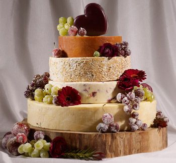 Cheese Stack Wedding Cake - Very Rustic - Some of the popular choices that have made many of the people their fans with their delicious tastes includes the names as like –      •Cornish Yarg /   •Dorset Blue Vinney   •Vulscombe goats' cheese  /  •Maryland cheddar  /   •Somerset Brie  /   •Somerset Camembert, and many more…  |  Great look for the cocktail hour.