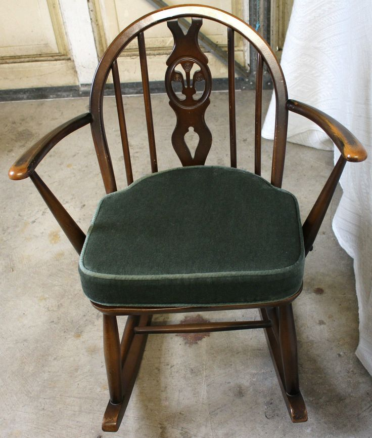 Vintage Children's Ercol Rocking Chair with fitted green cushion. Some general wear and tear but generally very good condition. Size is 24 inches across by 30 inches in height and 16 inches deep. Collection preferred from our shop in Corbridge, however we will ship if required