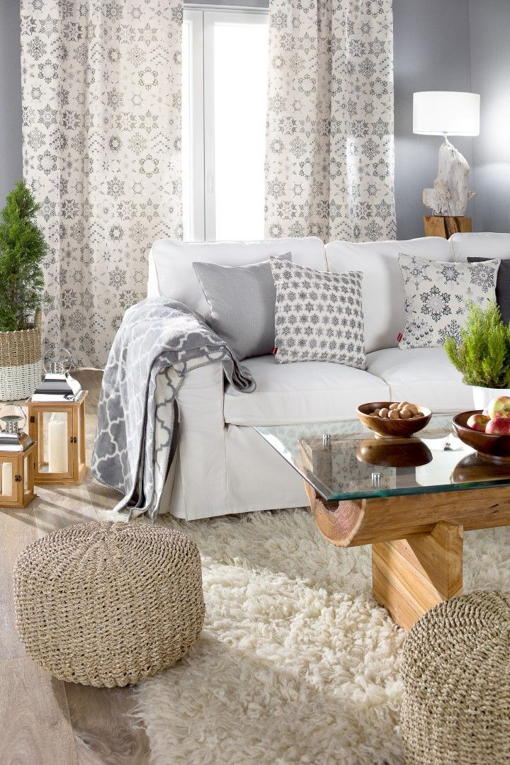 Scandinavian style floor length curtains (made to measure) and mix & match cushion covers with a cosy warm blanket for long winter nights.