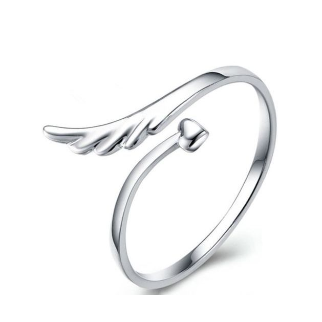 Angel Wing Ring. A dainty little ring that is well suited to being worn on the little finger or as a mid finger ring. Shop now at oliviasundayrose.com.