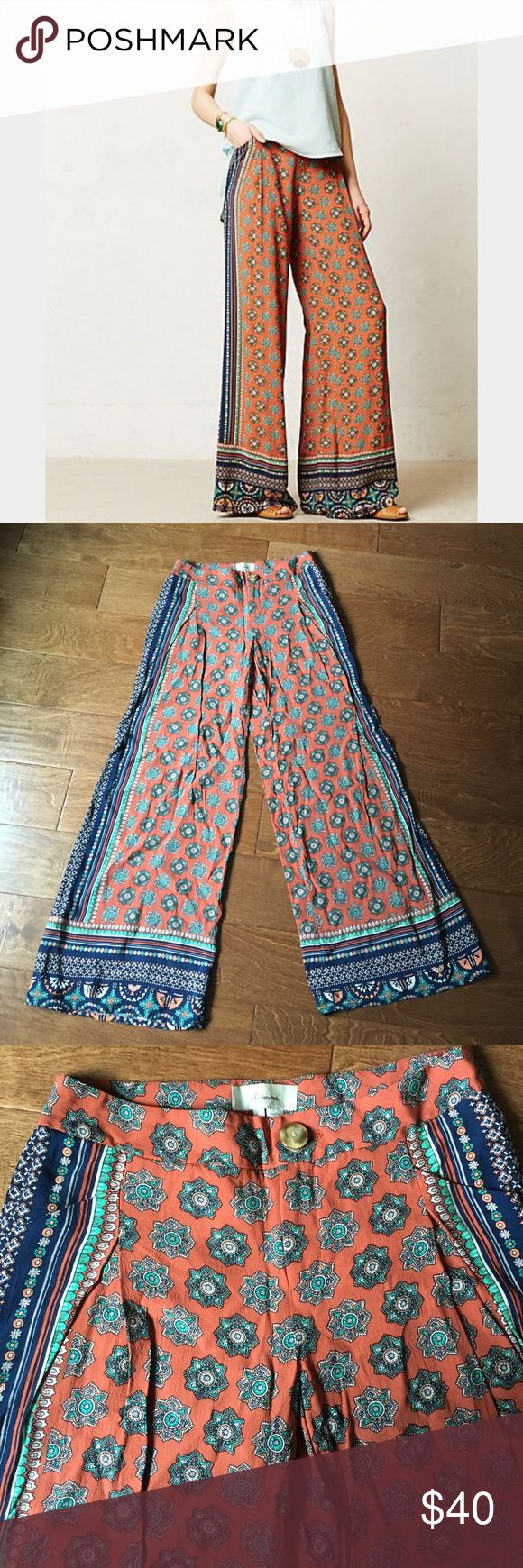 Printed Palazzo Pants Anthropologie brand Elevenses silky wide leg palazzo pants. Pumpkin orange base with navy panel down the sides. Other colors in pattern are cream and seafoam green. Zip and button front closure. Does have front pockets. Anthropologie Pants Wide Leg