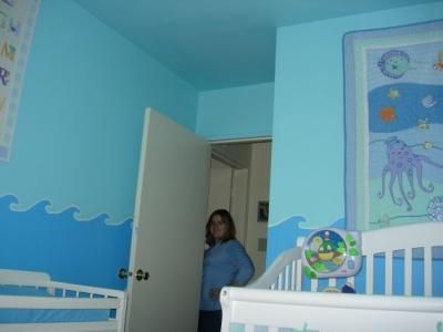 Ocean Theme Nursery Wall Mural Blue Purple and White Octopus Tropical Fish and More! To get our Ocean Theme Nursery decorating project started I just freehanded a sketch of some waves on the walls.  Once I had my sketches penciled in I