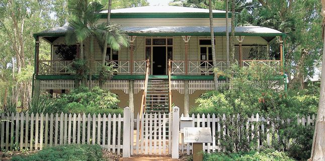 This Queenslander is in Cairns & I can just hear the patter of raindrops on its tin roof. Sigh!