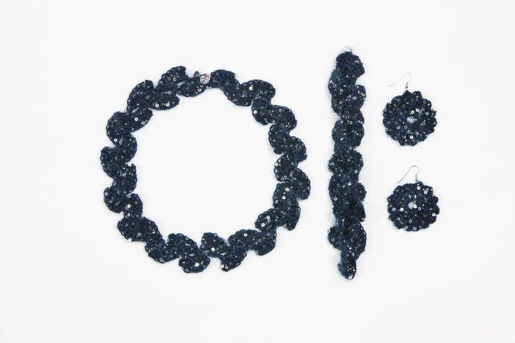 Crochet neckless, earrings and bracelet. Yarn: Artyarns Beaded Mohair & Sequins Published in Familien no 1/2015.