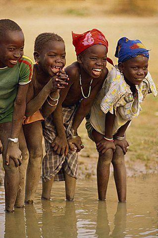 Smiling children . Niger River . Mali