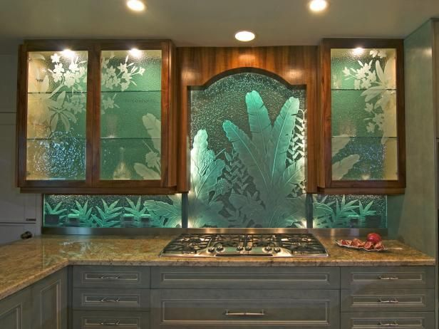 See the exquisite etched glass backsplash with a tropical plant design in this kitchen cooktop area on HGTV.com.