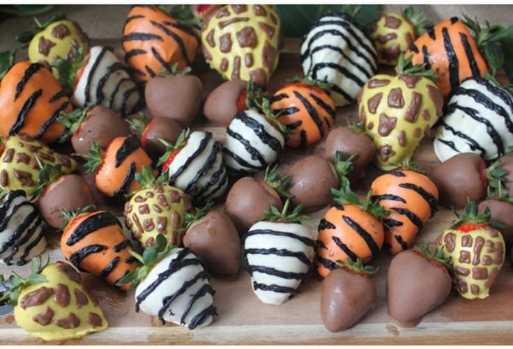 Jungle themed chocolate covered strawberries. - Pink with white polka dots for elephant theme?
