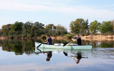 Katie O'Connell and Evan Gorelick paddle a canoe on the lower Wisconsin River, which features sandbars for camping in the summer.