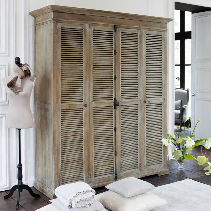 Shutters used as doors on a cabinet.