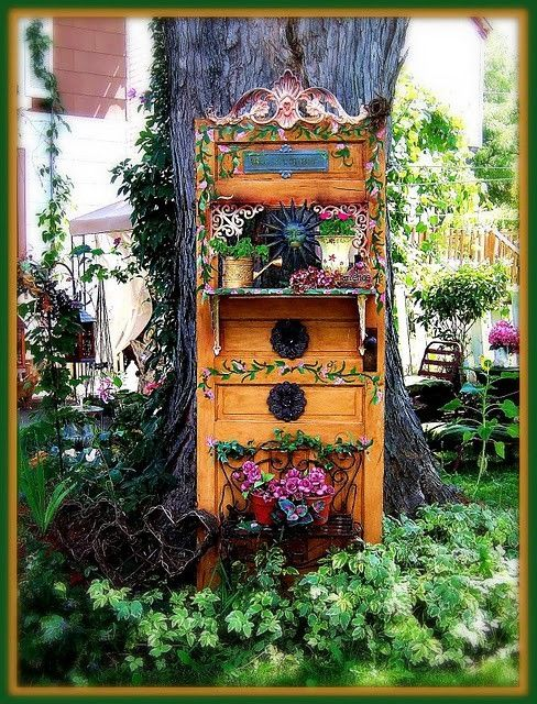 Garden art from old door. I adore this so much! But would put in potting shed...too pretty for damaging outdoors.
