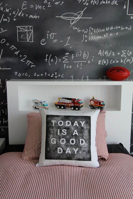 really like... chalkboard wall... colors... simple linens... :)