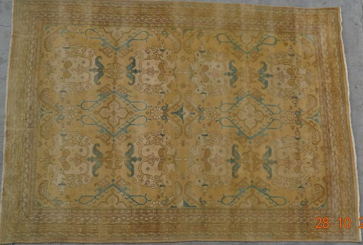 HAND KNOTTED TURKISH KNOTS RUG WOVEN BY ARTISTIC WEAVER USING HAND SPUN WOOL LOW PILE WITH WARM AND COOL COLOR .