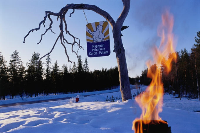 Fire and snow mark the gateway to the Arctic circle in Kuusamo.