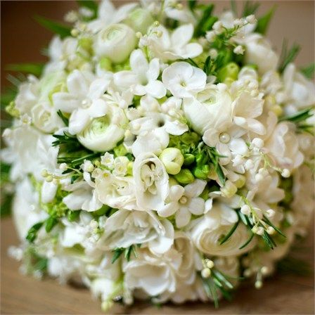 Lily of the valley, stephanotis, phlox, ranunclulus, and freesias.