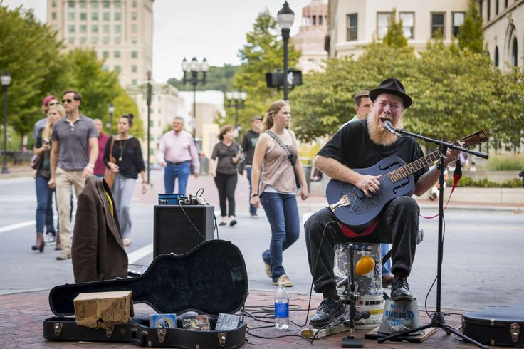 Street performers from around the world bring their talent to Asheville When Peter Levitov blows