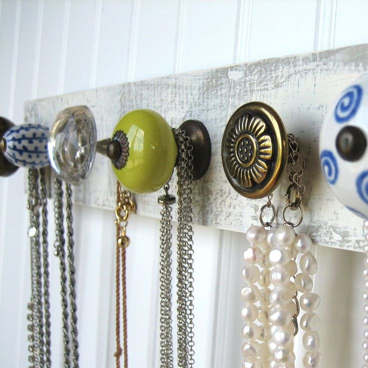 Necklace Organiser. I'm making something like this for my long necklaces. Love these cabinet knobs too.