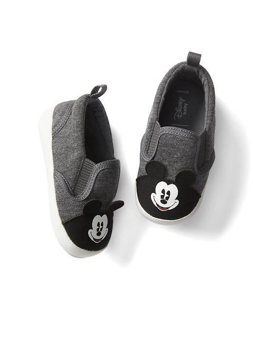 babyGap | Disney Baby Mickey Mouse slip-on sneakers in  light heather gray. The cutest shoes for your little mouseketeer. Soft cotton jersey upper with adorable  Mickey Mouse detailing at top. Features an easy, pull-on tab at back. Part of the Mickey Mouse collection from babyGap.