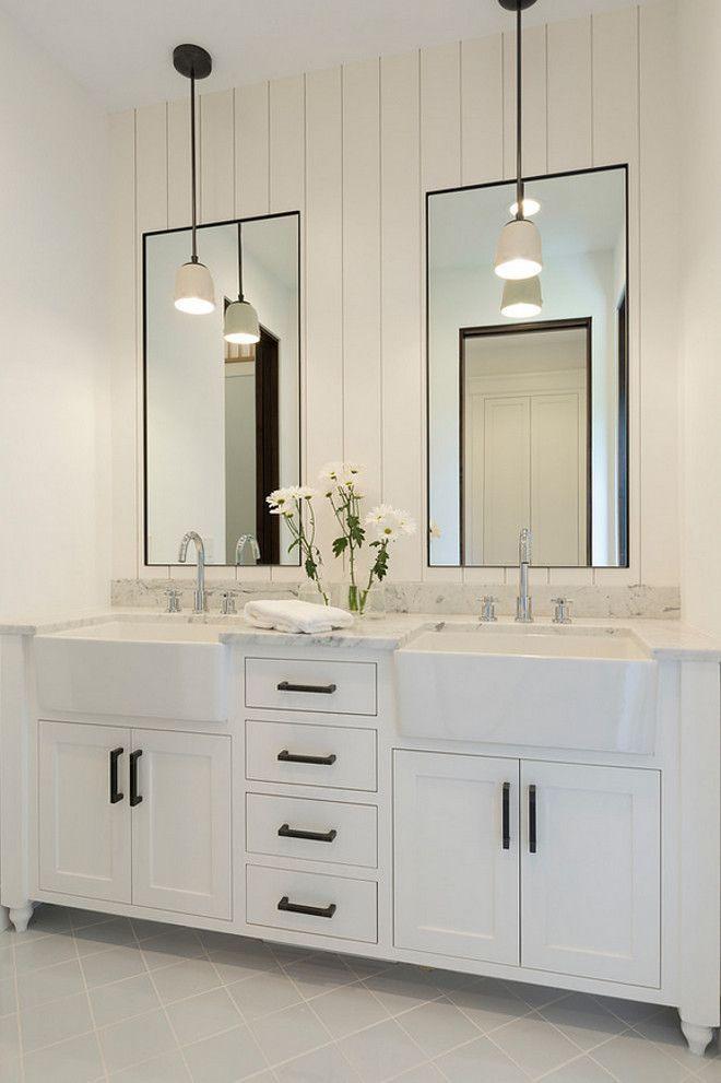 Bathroom shiplap wall behind mirrors. Bathroom with shiplap wall behind mirrors…