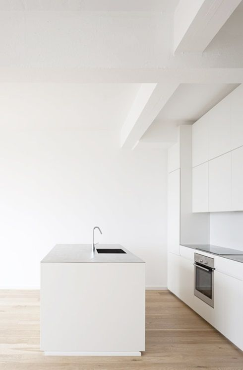 All White kitchen and white washed floors