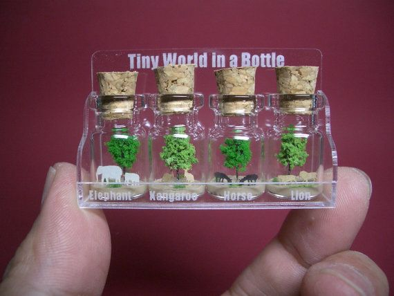 4 animal in 4 tiny bottles in a small cute by tinyworldinabottle