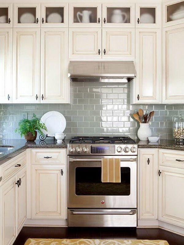 beautiful kitchen - love the pale blue gloss brick style backsplash against the white cupboards and dark wood floor