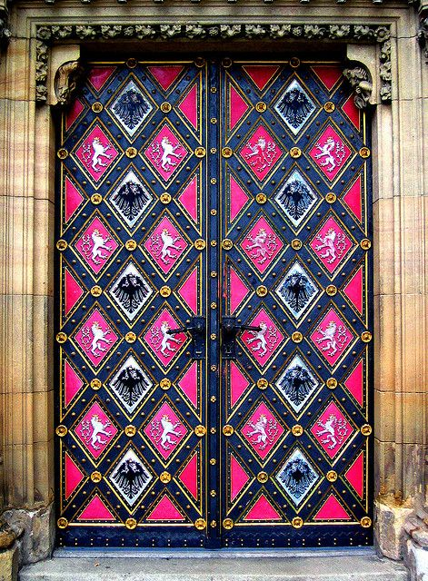 Pink and navy blue painted door. Prague