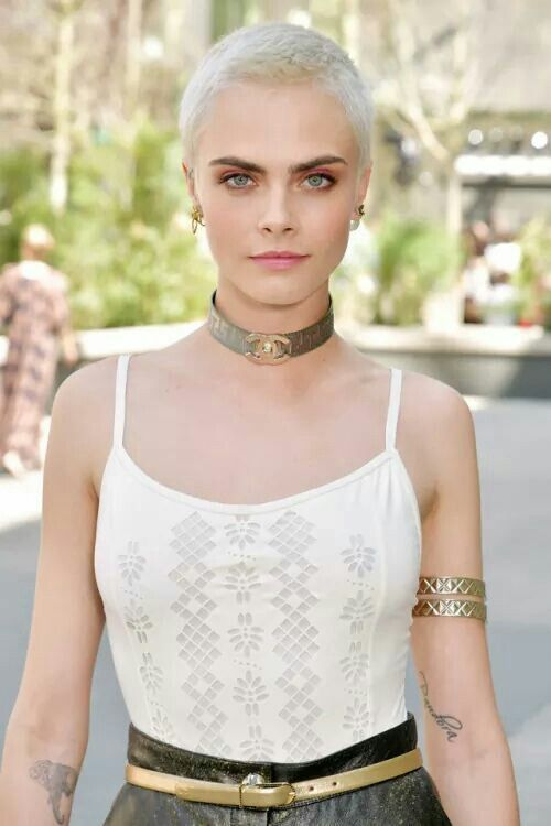 """Cara Delevingne, the latest puppet to shave her head.  Note the """"Pandora"""" tattoo on her left arm- """"Pandora's Box"""" is said to be a term used for """"Eyes Wide Shut""""-style """"Illuminati"""" masquerade parties."""