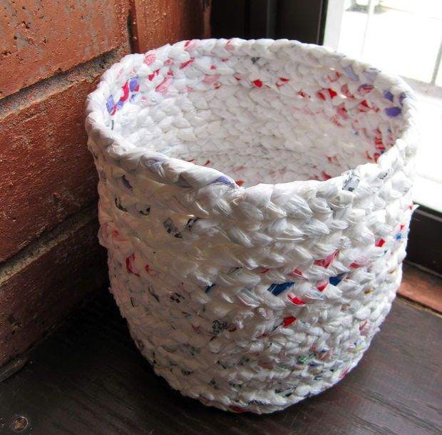 Basket made out of plastic shopping bags.  http://www.instructables.com/id/Make-a-basket-out-of-plastic-bags/?ALLSTEPS