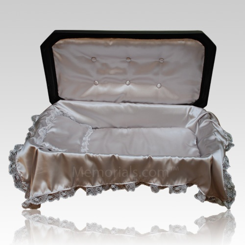 The Paradise Large Pet Casket will be a beautiful part of a memorial ceremony for your beloved pet. The piece is constructed of high impact, non-biodegradable, plastic materials, with a black exterior and comes outfitted with a comforting silver satin liner with elegant lace trim and a plush mattress with matching laced trimmed coverlet and pillow.