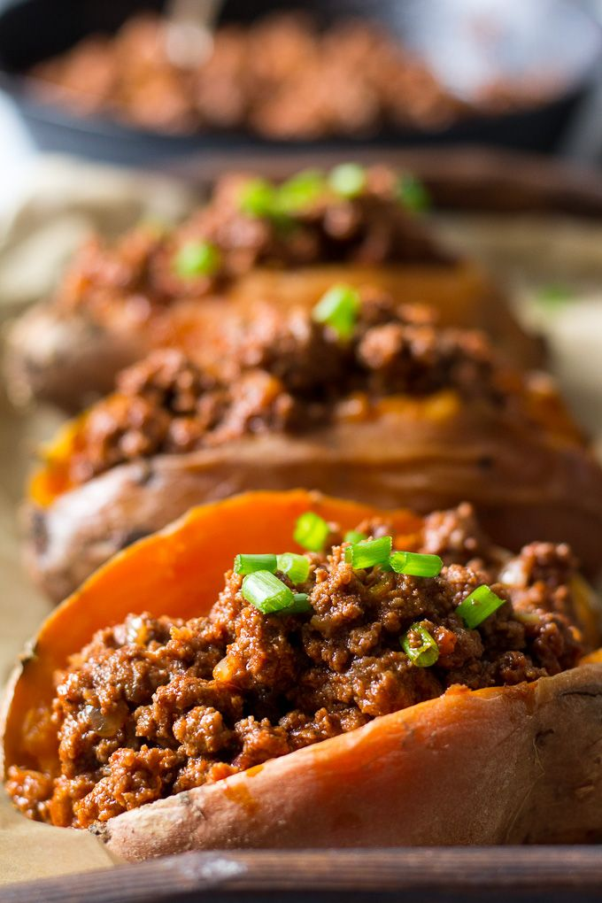 Easy Paleo and Whole30 Chili Stuffed Sweet Potatoes that are perfect for a healthy, filling weeknight dinner - Just bake the potatoes ahead of time!