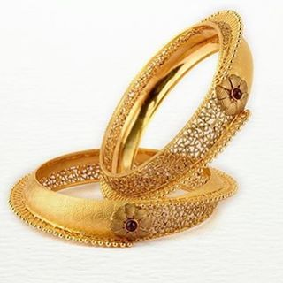 """Jaali work meets bold design, these kadas are all about understated glamour! #goldjewellery #bangles #indianbrides"""
