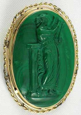 Scarce gold mounted Victorian carved malachite full body antique cameo brooch- Terpsichore (mythological muse or Goddess of music) standing by a tall pedestal.