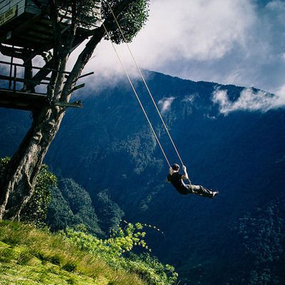 """Swing at the End of the World via atlasobscura: Deep in the Ecuadorian wilderness is a seismic monitoring station known as Casa del Arbol or """"The Treehouse"""" because it is simply a small house built in a tree used for observing Mt. Tungurahua, the active volcano in the near distance. The simple swing lets you swing 2,600 m above sea level. #Swing #Ecuador"""