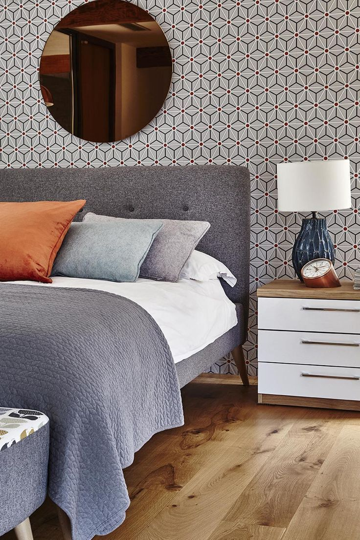 Get the retro look in your bedroom with Fontaine grey fabric bed frame. Add orange cushions and copper accessories for a pop of colour.