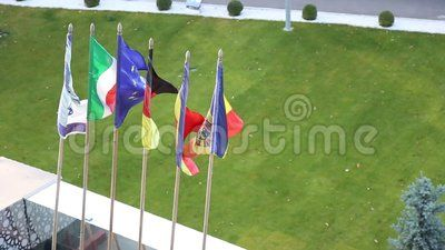 Flags waving at the hotel entrance.