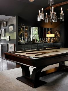 Eclectic Game Room with High ceiling by Kellie Griffin Interiors, Inc. | Can your dining room be turned into a billiards room? Love the contemporary pool table...looks like the Treviso by Brunswick which is about a $7,000 pool table...