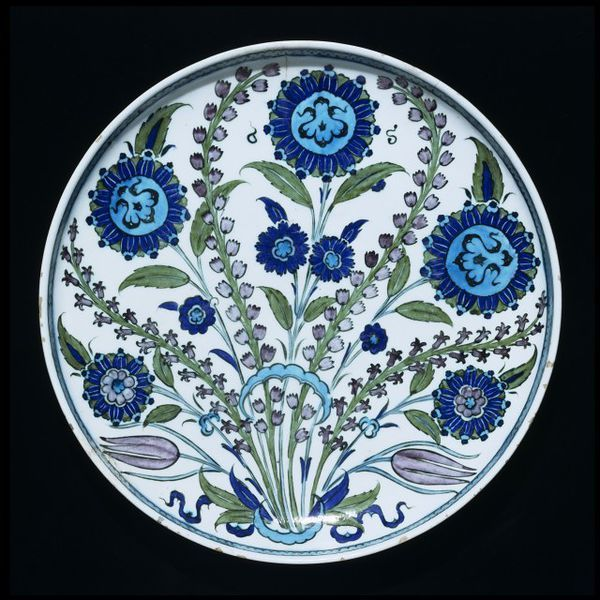 Dish | Iznik, Turkey, ca. 1550 | Materials: fritware, polychrome underglaze painted, glazed | Iznik has given its name to some of the most accomplished ceramics produced in the Islamic Middle East | In the 1460's or 1470's, under the patronage of Sultan Mehmet the Conqueror, they began to manufacture bowls, dishes and other pieces of fritware that were elegant in shape and decoration, and often very large | VA Museum, London