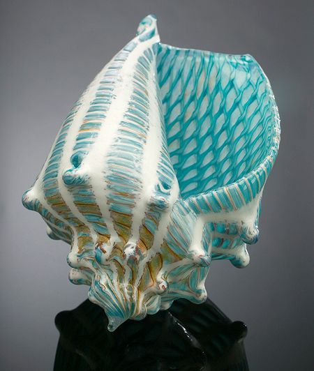 Silkwood Glass. Am torn tween my love of pattern, turquoise and the pure  form of the conch shell--and my sens that this is a touch overdone.