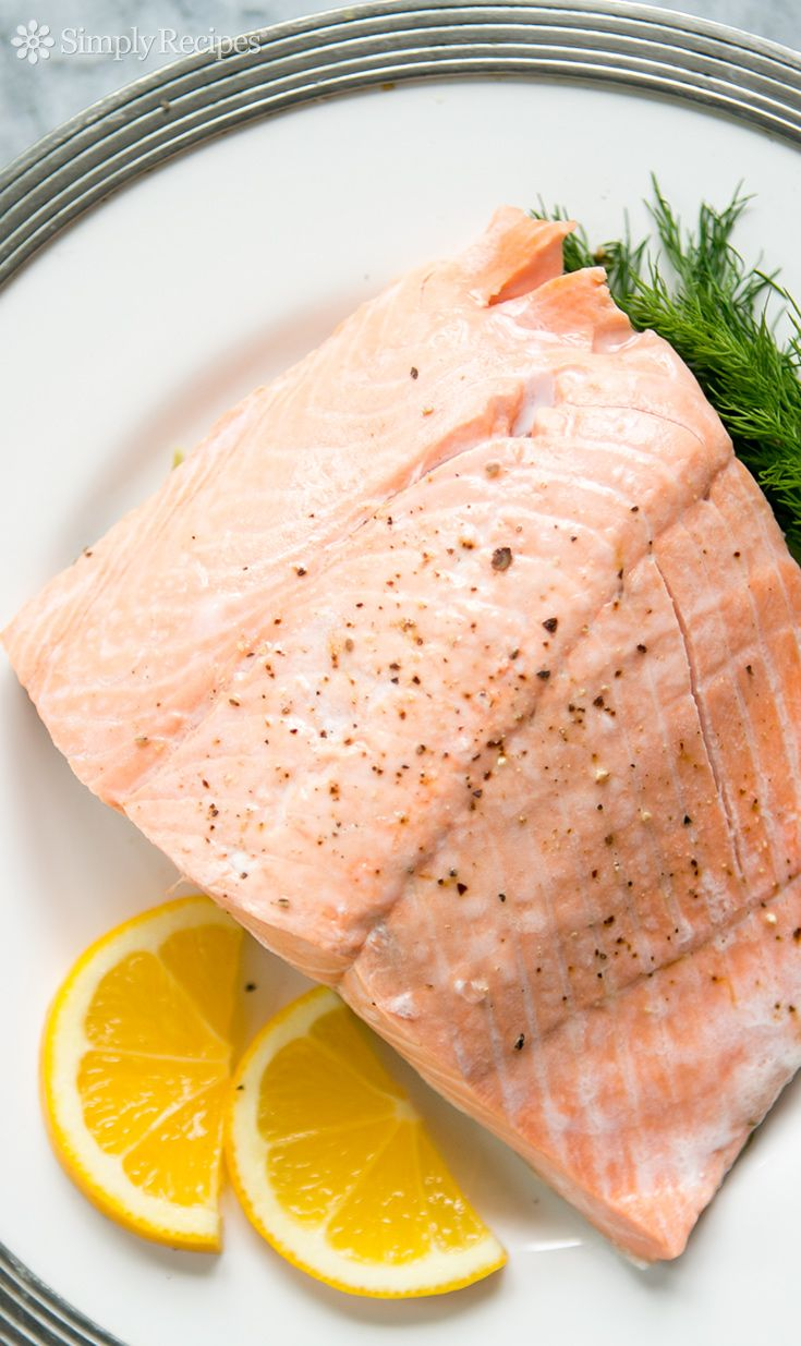 Poached Salmon ~ Poach delicious salmon steaks or fillets in only 15 minutes! Salmon poached in white wine, seasoned with fresh dill. ~ SimplyRecipes.com