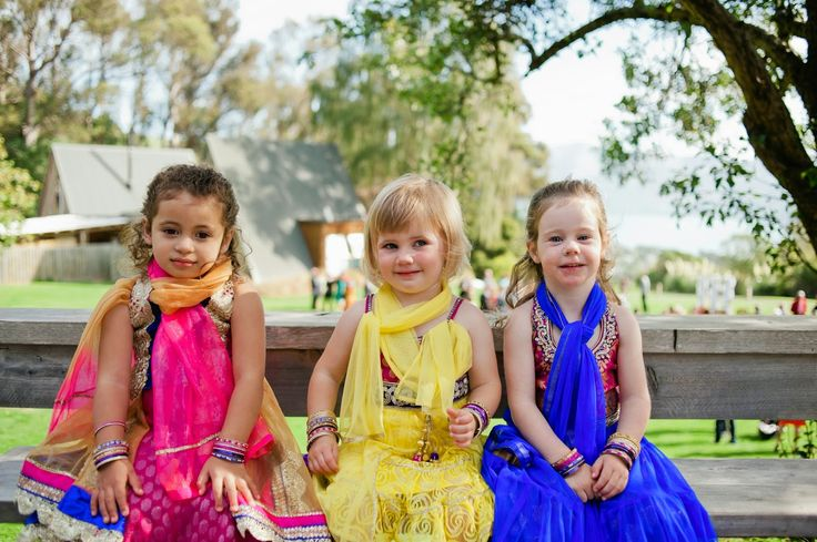 Flower girls in Indian Choli' dresses. Groom was indian, so a nice way to incorporate culture into a western wedding