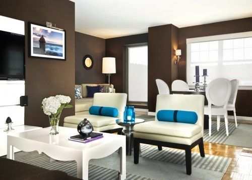 Modern Living Room The Brown Wall Color Is Stunning Against The Cream Decor With Teal Accents